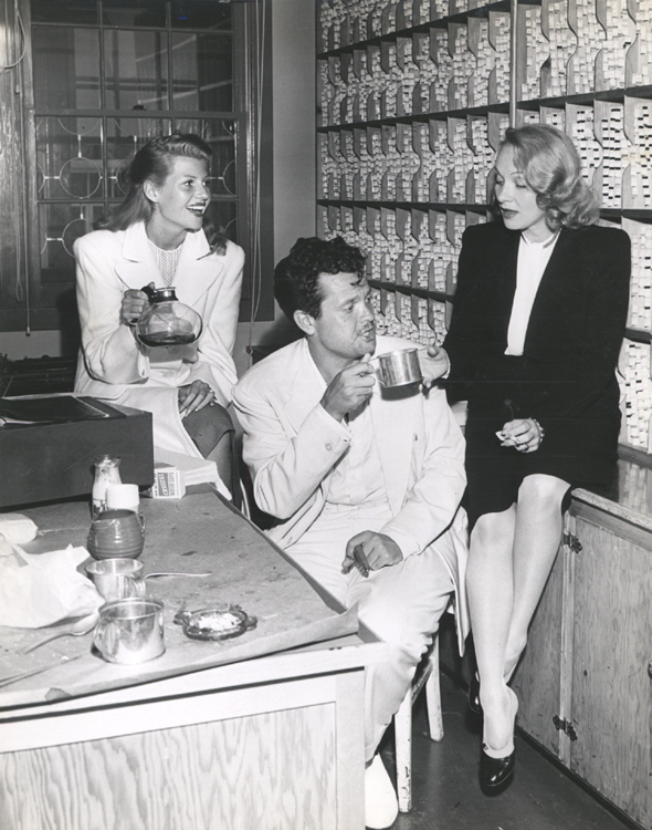 Rita Hayworth, Orson Welles and Marlene Dietrich relax after announcing the news