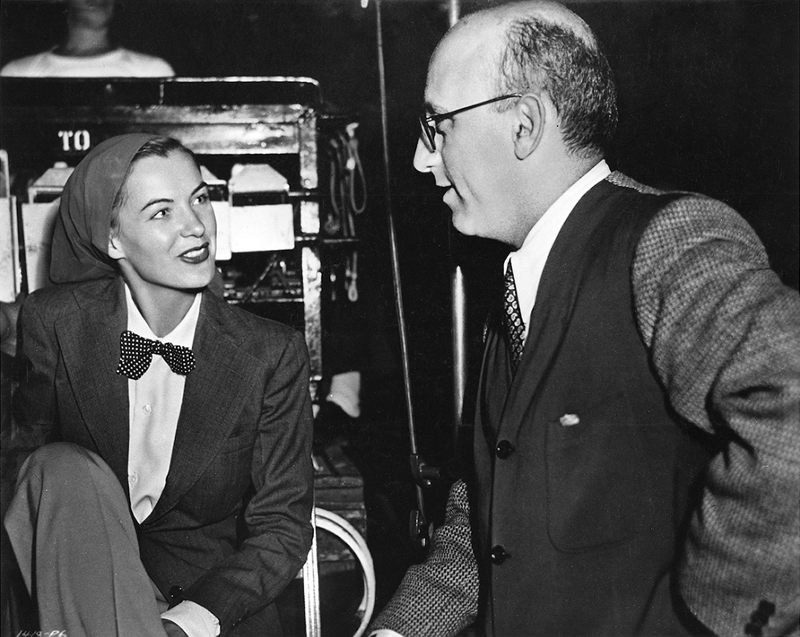 Ella Raines on set with Robert Siodmak in 1944