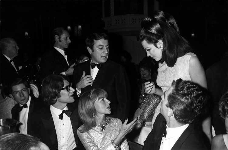Princess Ira von Fürstenberg socialising with Yves Saint Laurent